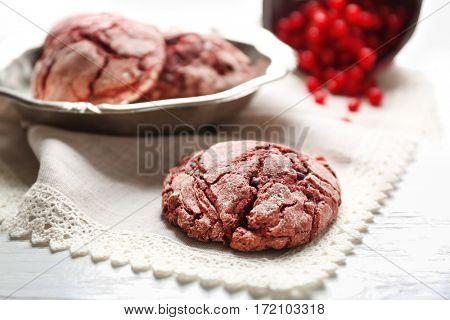 Closeup of tasty chocolate cookie on white napkin