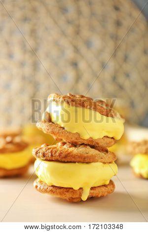 Delicious lemon ice cream cookie sandwiches on kitchen table