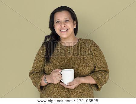 Woman is smiling holding coffee mug