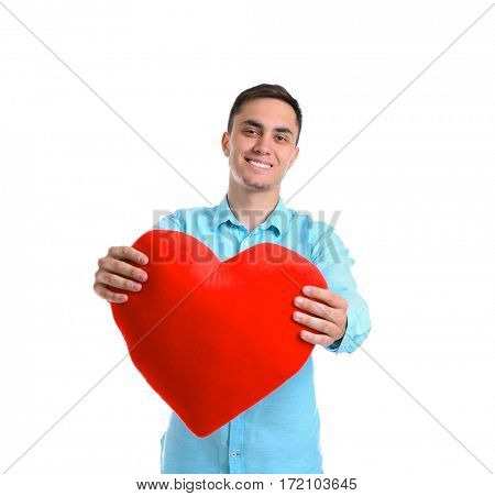 Handsome man holding red heart on white background