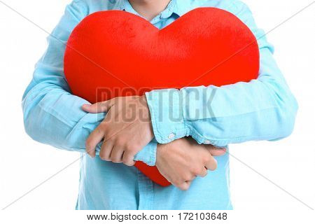 Man holding red heart on white background, closeup