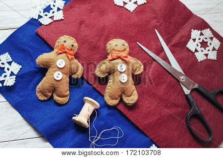 Christmas toy on a wooden table. Cute decorations on the Christmas tree. Creative art and craft idea for kids. top View. In anticipation of the holiday.