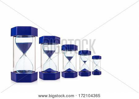 six hourglasses on white background showing blue sand dropping down mearsure and concept of time room for copy space selective focus at the center of hourglass