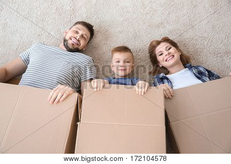 Happy family packing and having fun. Moving concept