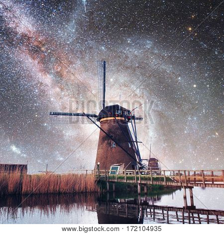 Dutch mill at night. Starry sky. Courtesy of NASA. Holland. Netherlands
