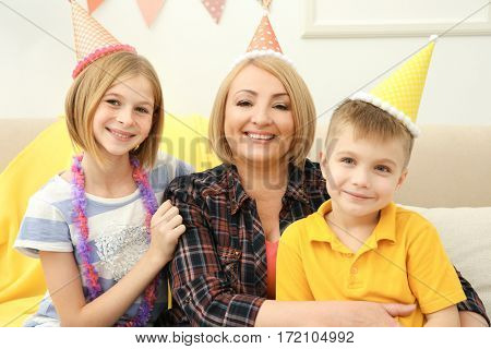 Birthday party. Portrait of granny with adorable children