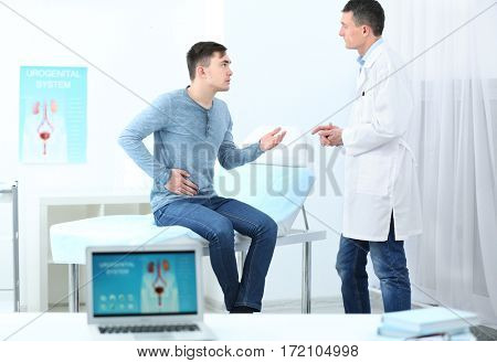 Man visiting doctor at hospital