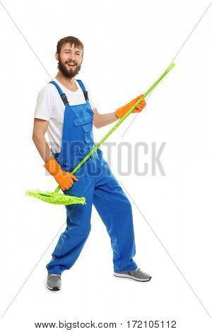 Funny young man with green mop on white background