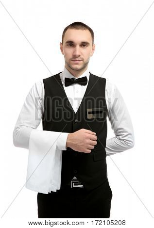 Young handsome waiter with napkin standing on white background