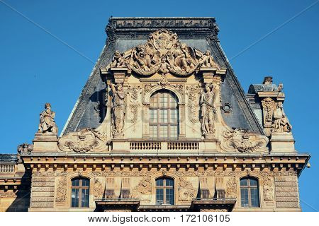 PARIS, FRANCE - MAY 13: Louvre museum closeup exterior view on May 13, 2015 in Paris. With over 60k sqM of exhibition space, Louvre is the biggest Museum in Paris.