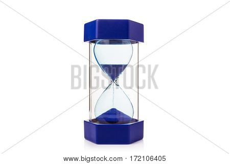 hourglass on white background showing blue sand dropping down mearsure and concept of time room for copy space selective focus at the center of hourglass