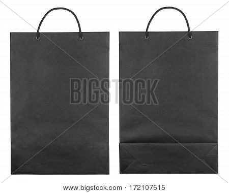 Black paper bags isolated on white background. Flat lay