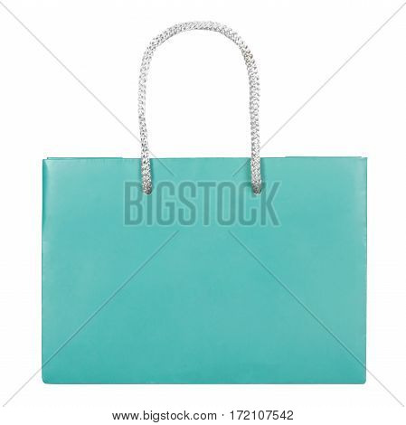 Turquoise paper bag isolated on white background. Flat lay