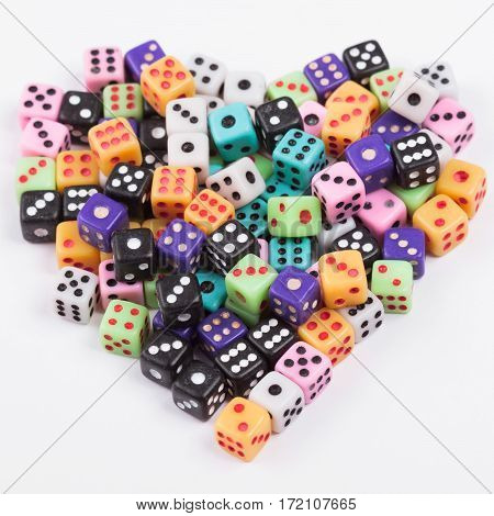 Gambling addiction concept. Gaming dice heart symbol on white. Love gambling