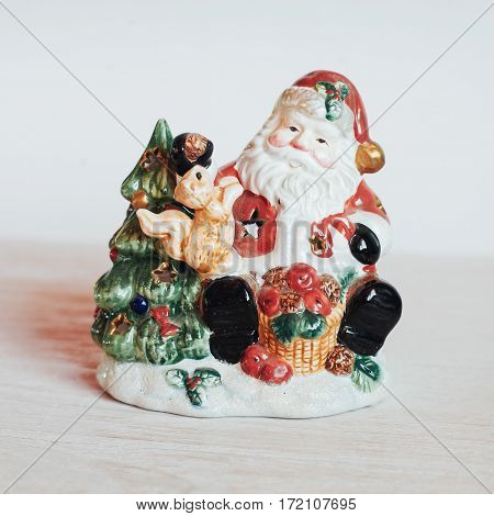 Santa Claus with gift - toy - isolated on white background.
