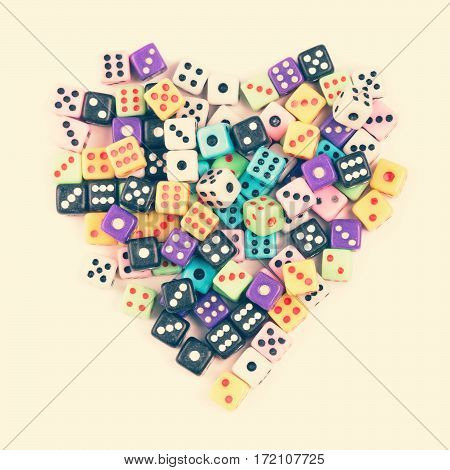 Gambling addiction concept. Gaming dice heart symbol. Above view