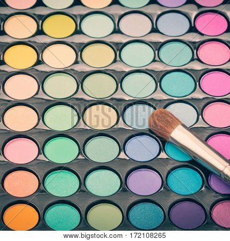 Make-up eye shadow palette with shadow brush