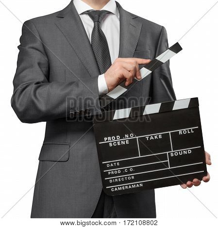 Man wearing costume holding clapper board on white