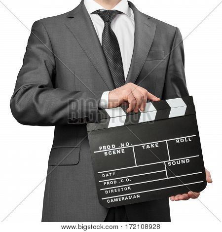 Man wearing costume holding clapper board on white background