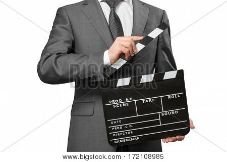 Man wearing tie and costume holding movie clapper board isolated on white