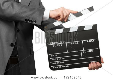 Closeup of man holding movie clapper board isolated on white background