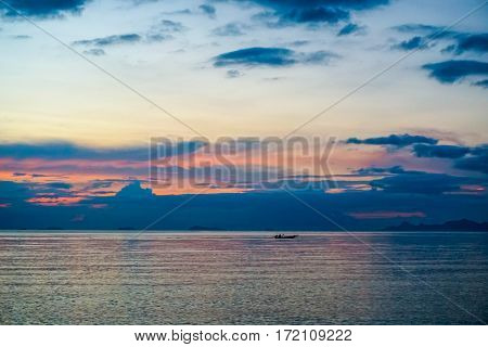 Fisherman Boat Sailing at Sunset in Thailand