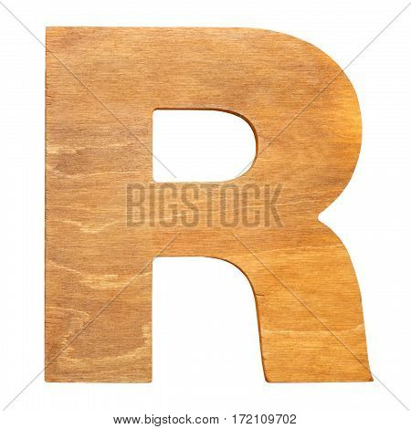 Old wooden letter R on wooden background. One of full alphabet wooden set