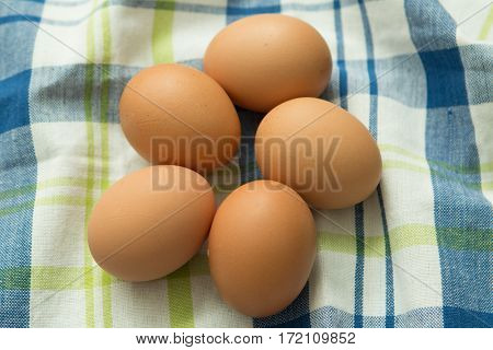 Raw eggs on a blue napkin. Healthy meal