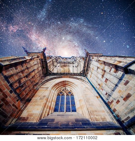 St. Vitus Cathedral at Prague Castle in Prague under Clear Blue Sky Sunny. Fantastic starry sky and the milky way. Courtesy of NASA.
