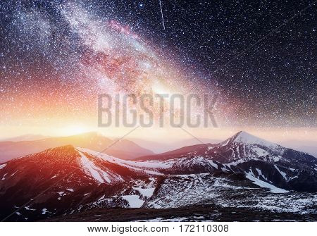 Fantastic starry sky. Beautiful winter landscape and snow-capped peaks. Picturesque Mountains. Mountain view. Courtesy of NASA. Carpathians, Ukraine, Europe