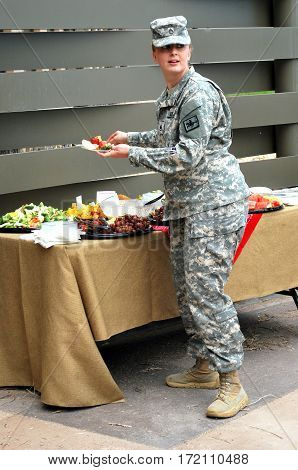 JUNE 5, 2014. CHEYENNE, WY. CIRCA:  Female army soldier attending a military brunch on the base.