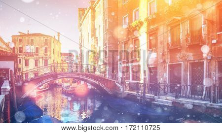 Canal with gondolas in Venice, Italy. Photo greeting card. Bokeh light effect, soft filter.