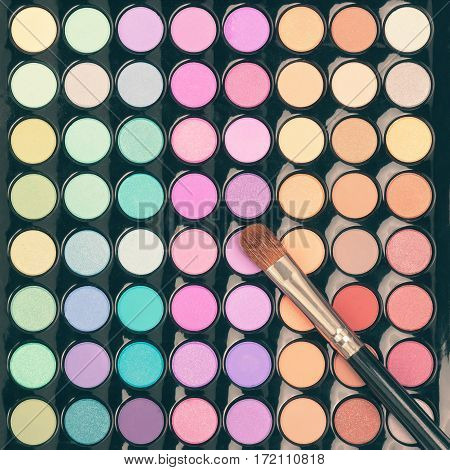 Colorful makeup palette with makeup brush. Flat lay