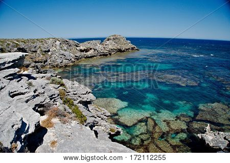 Rocky cliff with crystal blue sea water