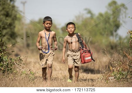 Two Rescuers boy in countryside outdoor go to help people