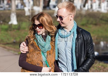 closeup of a caucasian and loving couple is kissing. lifestyle, people and outdoor concept and idea