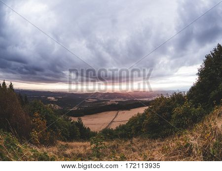 Beautiful sunset with dramatic storm clouds over rural Oregon countryside. Near Newport Oregon USA.