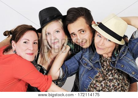 Happy smiling young hipster group is joking with funny hats. Party feeling, Isolated on white background.