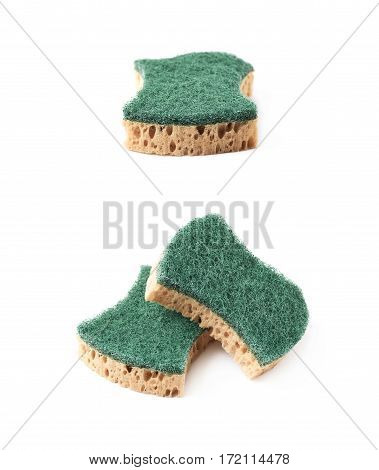 Pile of two artificial fiber kitchen sponges isolated over the white background, set of two different foreshortenings