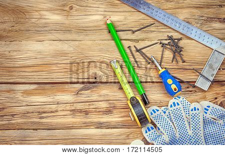 gloves and tools on wooden table. A close up