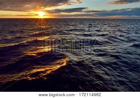 Sunrise on the sea. Beauty sunrise. The sea on a background of sunrise. Summer, early morning sea waves. Black Sea near South Ozereyevka, Novorossiysk, Russia