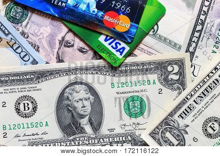 Photo Of Visa And Mastercard Credit Card With Usa Dollars Bills.