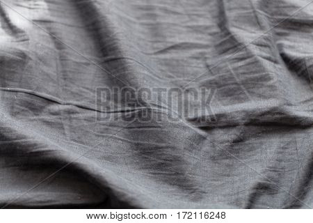 Black textile with waves as background or texture.