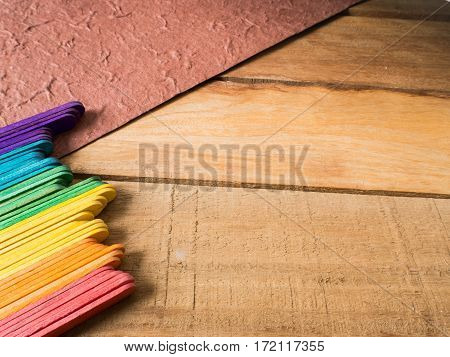 Colorful background wooden sticks staying on wood over valentines day concept.