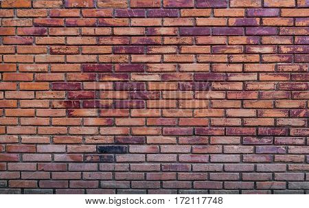 Old red color vintage brick wall background.