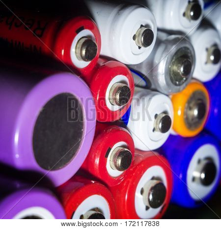 AA, aaa, 18650 batteries Energy abstract background, close up