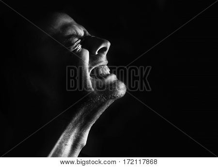 guy, a man in pain agony clenched teeth, black and white portrait, evil