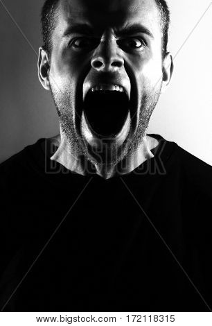 screaming angry aggressive militant guy, black and white portrait