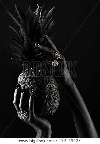 Beautiful Hands With Rings On The Fingers. Hands Holding A Pineapple.