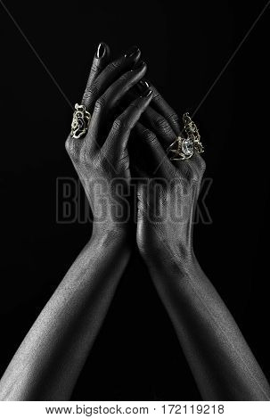 Dark-skinned Hand With Jewelry On A Black Background